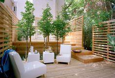 Wonderful private backyard retreat. The horizontal fence, two levels and foliage make it.