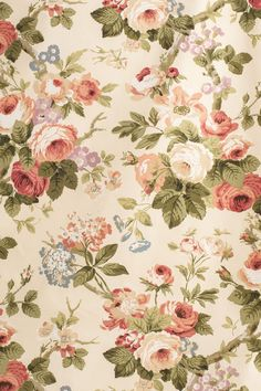 """Jean Monro AUTUMN ROSES, Stock #: JM711, Colour: Apricot/Olive Green, Width: 130cm./51"""", Repeat: 90cm/35.5"""", Composition: 100% cotton. This faithful copy of a handblock print last produced in 1979, is the quintessential English Chintz so loved by the Victorians. It has large softly coloured Roses, with hints of Hydrangeas, Morning Glory and Primulas against rich green leaves, on a plain tinted ground."""