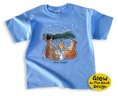 Share your love of star gazing with this cute, hand-drawn kids' t-shirt that glows in the dark!