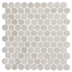 Onix x Glass Mosaic Tile in Pearl offers a bold and modern option in a hexagonal pressed glass mosaic format. This beautiful recycled material mosaic has a sand blasted finish enhanced by a unique iridescent coat that creates a dramatic effect. Calacatta Gold, Glass Installation, Tiles Online, Shower Floor, Shower Pan, Glass Mosaic Tiles, Porcelain Tile, Tile Design, Colored Glass