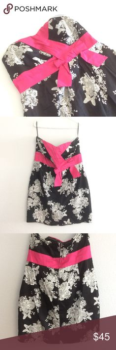 Torrid strapless dress In excellent pr loved condition. No rips or stains. Size 16. Self is 97% cotton, 3% spandex. Contrast is 97% cotton, 3% spandex. Lining 100% polyester. Dry clean only. Zipper in the back. Pockets on the sides. 18.5 inches across the top. From top to hem measures 28 inches. Across where bow is measures 18.5 inches. torrid Dresses Strapless