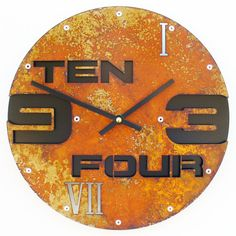 This modern clock uses material cutouts to depict numbers in a variety of ways (standard, written, and roman numeral). The purpose of the missing material is to allow the color(s) behind the clock to show through creating a more integrated wall feature. It also features background pieces which can be colored differently than the foreground for more contrast.  Outnumbered II Modern Wall Clock Rusted w/ Back by All15Designs