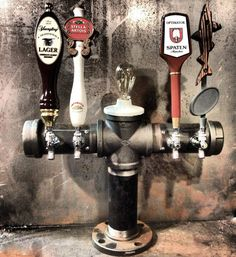 Custom 4 tap draft beer tower iron pipe with Edison bulb in the middle! I could totally make this!