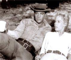 Elvis taking a break with Barbara Eden between takes in august 1960.