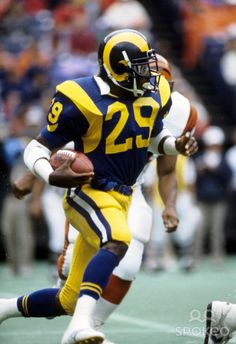 Eric Dickerson, running back, Los Angeles Rams. Dickerson holds the NFL single-season rushing record with yards, set in Cardinals Kurt Warner jersey But Football, Nfl Football Players, Football Memes, School Football, Sports Memes, Football Cards, Eric Dickerson, Nfl Rams, Nfl Uniforms