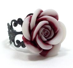 """Ring Flower Cocktail Maroon White Rose . STARBURST    Intriquing maroon and white swirled rose flower cabochon sits atop a gunmetal filigree adjustable band. This ring is such a fun, stylish accessory! Item ships worldwide in a Hot Pink Chick box, perfect for gift giving.    • Ring is adjustable, will fit most.  • Flower measures 7/8""""."""