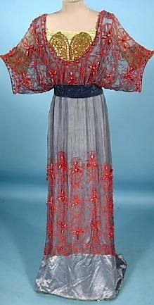 Red Lace over Gray Satin with Gold Brocade Bodice - interesting concepts of design. The Kimono style sleeves and the gold hidden bodice quite a mix of styles and colors.    1912 Dress.