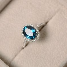 London blue topaz ring oval gemstone sterling silver by LuoJewelry