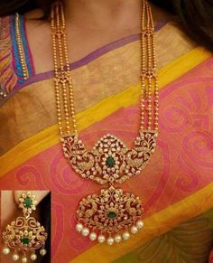 unique three layer long necklace set in white red and green stones with coordinated earrnings. Gold Earrings Designs, Gold Jewellery Design, Necklace Designs, Gold Jewelry Simple, Simple Necklace, Indian Wedding Jewelry, Bridal Jewelry, Indian Jewelry, Indian Bridal