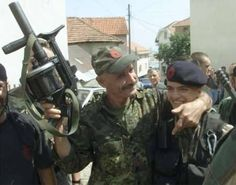 Kosovo Liberation Army forces celebrate, 1999.