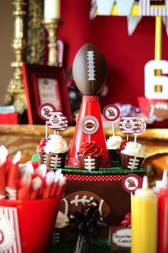 megaphones and foam footballs from the Dollar Tree as cute centerpieces for turf-topped cupcake stands. These kinds of DIY projects that won't break the bank but are fabulous for setting a party theme.