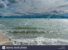 Download this stock image: View over the Menai Strait taken from Beaumaris on the Isles of Anglesey, North Wales, UK. - E7MNWX from Alamy's library of millions of high resolution stock photos, illustrations and vectors.