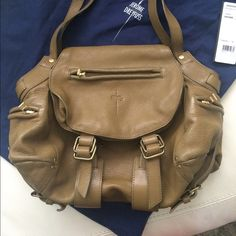 """Jerome Dreyfuss Twee Great neutral handbag! Olive green. Very good Preowned condition. There is some slight color transfer on the back of the bag. Inside is clean but flashlight is not working. Approximate measurements: depth 4"""", width 13.5"""" & height 9.5"""". Jerome Dreyfuss Bags"""