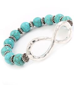 """This bracelet is made with natural stone and crystal studs and finished off with an infinity symbol constructed in hammered rondelle. The bracelet is metal casting and stretches to fit most ladies. Size: 3/4"""" Width - Color: Turquoise $15.99"""