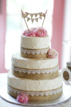 Burlap/lace cake with flowers and 'Just Married' cake topper. Photography By / http://jenlynnephotography.com