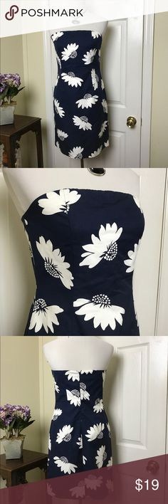 """Tommy Hilfiger Strapless Dress Tommy Hilfiger Strapless floral sheath dress. Fully lined. 100% Cotton. Featuring oversized blooms over a navy blue backdrop. Strapless rubber strip across top to hold dress in place. Chest pit to pit 16"""", Waist 30"""", Length approx 30"""". Tommy Hilfiger Dresses Strapless"""