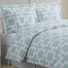 A graphic link pattern is shown off in a fresh mint color on this cotton bedding. | $79.99