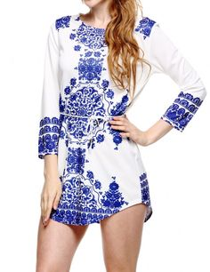 Product Description: Woman's Elegant Blue And White Printed Irregular Hem Stylish 3/4 Sleeve Mini Dress With Belt. Material: Polyester, Color: White and Blue, Collar: O-neck, Sleeve: 3/4 Sleeve, Style