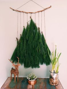 This was a favorite Christmas Tree wall hanging I made from left over pine garland. DIY from pine garland, coir roping and a stick. Such a unique Christmas Tree DIY Decoration! I can't wait to make one again! Bohemian Christmas, Natural Christmas, Simple Christmas, Winter Christmas, All Things Christmas, Christmas Home, Handmade Christmas, Wall Christmas Tree, Modern Christmas