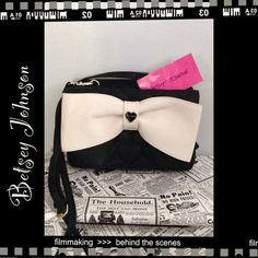Betsey Johnson Cross-body Bag Black and cream bow cross-body bag. Has 2 sections- front has a wallet area for money, credit cards and id. Separate sections of bag for makeup etc. beautiful bag. Betsey Johnson Bags Crossbody Bags