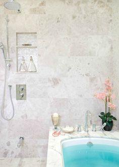 Kelly Stoneburgh Interiors - Spa ensuite with travertine tiles backsplash, soaking tub and rain shower head.