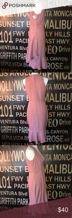 """NWT Deep V elegant dress Gorgeous deep V dress with a flare side and bottom! Beautiful on!!! YOU NEED THIS for your next occasion! Mannequin is size Medium 6-8 Size 34"""" 26"""" 35"""". Dresses Asymmetrical"""
