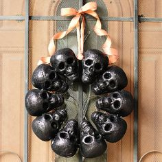 Make this super fun Halloween Skull Wreath with just 10 skulls (from the dollar store!), wire, and ribbon. Even includes flashing lights!