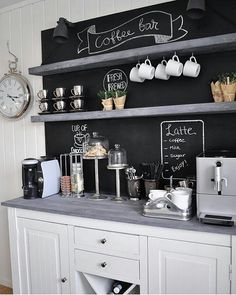 10 DIY Coffee Bar Cabinet Ideas for the Perfect Cup of Joe - large white coffee cabinet bar with chalkboard wall, grey countertops, matching grey shelves, mugs and coffee add ins Coffee Station Kitchen, Coffee Bars In Kitchen, Coffee Bar Home, Home Coffee Stations, Coffee Coffee, White Coffee, Coffee Maker, Coffee Enema, Coffee Dripper