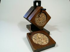 A beautiful hardwood coaster set with stand. The six square coasters measure 3 3/4 inches across the whole thing, and the center circle is 3 inches in diameter. The stand is 6 1/4 in. tall, 6 1/2 in. long and 3 1/4 inches wide. One of the cork centers has been replaced and looks different from the others. Otherwise excellent vintage condition!  I refund shipping over charges, and am happy to combine shipping costs. From an non-smoking, pet free home.  Visit my shop for mor...
