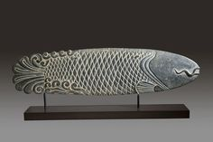 """Chinese, 17th century (late Ming) stone carving of a stylized fish. From a temple in Shanxi Provence. 47"""" long x 12 1/2"""" high."""