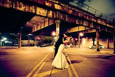 """I love taking the bride and groom out for night shots. It's often the first time they get to be """"alone"""" after getting married. Plus it's just awesome."""