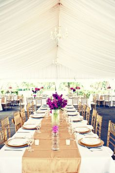 Centrepieces of varying heights add interest to reception tables