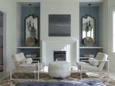 transitional living room by Angela Free Design; display shelving either side of fireplace; chairs CB2 then customized