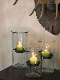Create beautiful custom displays with hurricane candle holders. Includes a rustic insert to hold a candle and a hammered wavy glass finish.