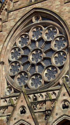 CHAP 9: This is an example of a Rose window. Rose windows are circular windows divided into segments by mullions with glazed openings. These are typically found high on the wall of cathedrals and churches.