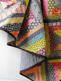 string quilt using Denyse Schmidt Hope Valley.  Kona Raison for binding.