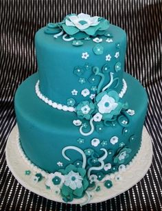 Teal or aqua cake with fondant flowers. This would be a nice bridal shower, baby shower, or birthday cake. Fancy Cakes, Cute Cakes, Pretty Cakes, Turquoise Cake, Teal Cake, Ivory Wedding Flowers, Teal Flowers, Unique Cakes, Creative Cakes