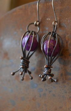 whimsical oxidized copper wire earrings with purple magnesite bead and sterling silver ear wires