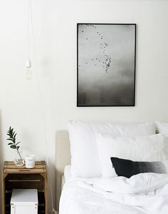 Calm bedroom with 'Getaway' print by Finish Jaana Komulainen | www.theposterclub.com