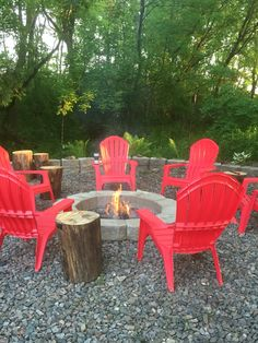 Fire pit, red chairs and diy log end tables