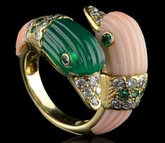 Unusual multi-gem ring of double-head design in alternating fluted chrysoprase and fluted coral each with a diamond and emerald band, diamond beaks and emerald eyes Van Cleef Arpels, Paris 1969 Van Cleef And Arpels Jewelry, Van Cleef Arpels, Coral Jewelry, Fine Jewelry, Jewelry Box, Emerald Band, Animal Jewelry, Jewelery, Vintage Jewelry