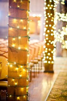 Give rustic pillars an upgrade by wrapping them in twinkling lights (ask your venue for permission first)