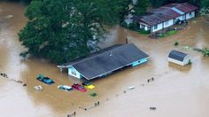 """08/14/2016 - At least three people die and thousands are rescued as """"historic"""" flooding swamps the US state of Louisiana."""
