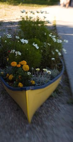 How cute would this be at a beach house?  Turning a old boat into a garden #planter.  Adorable.