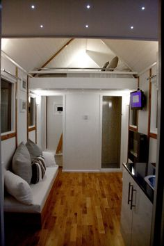 This 150 sq.ft. tiny house was created by Mark Burton of Tiny House UK.  The bedroom loft is accessed by ladder from the back instead of having the ladder in the middle of the house.