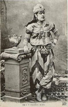 Postcard photograph of a 'köçek' (male dancer) posing in costume. Istanbul, late 19th-century.
