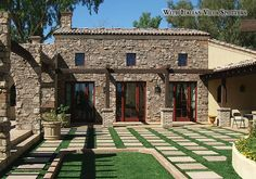 Tuscan Villa® - Romano - with Italian Villa Spotters - Manufactured Stone Veneer. In Tuscany, Coronado found an architectural style of stone which inspires warmth and charm. The minimal profile and rich earthy hues of Tuscan Villa® help to recreate that aesthetic quality.