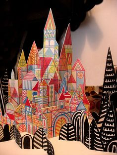 Make a colorful castle from cardboard by cutting it up and adding your own decorations || #LittlePassports ...brownpaperbag.