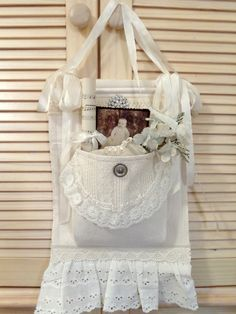 Love this shabby fabric pouch made from old white sweater pocket, lace  ribbon.