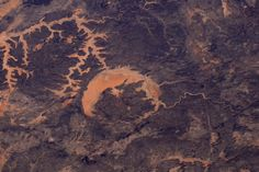 Apr 23  Crater in #Africa. @Space_Station #EarthArt #Explore   Tim Kopra (@astro_tim) | Twitter